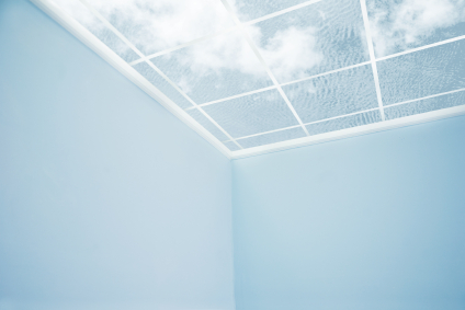 Blue sky and clouds through a window roof
